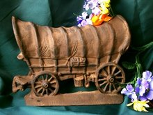 CAST IRON COVERED WAGON DOORSTOP