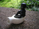 BLACK AMERICANA BOY ON POT BANK CAST IRON  B