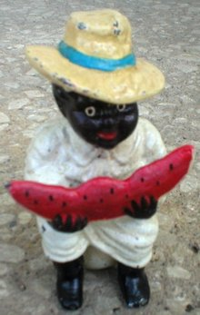 BOY EATING WATERMELON BLACK AMERICANA BANK CAST IRON