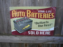 AUTO BATTERIES SOLD HERE TIN SIGN