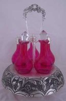 CRUET SET 5 CRANBERRY GLASS BOTTLES