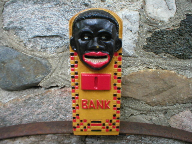 BLACK AMERICANA STILL BANK CAST IRON