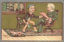 Victorian Trade Card Boy Showing Tie Samples with Gold Background
