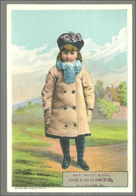 Victorian Trade Card for Nat. Wolfe & Co. , Druggists Little Girl Dressed Winter