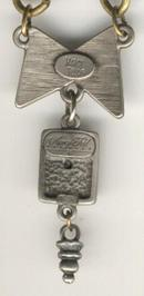 Marcy Feld Metal Necklace Bow and Leaf Charm