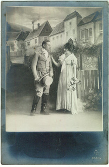 Photo postcard of Couple Dressed Up on Set