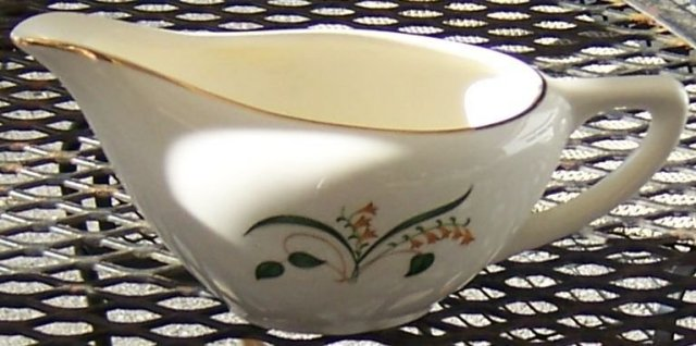 Retro Pottery Creamer with Floral Design