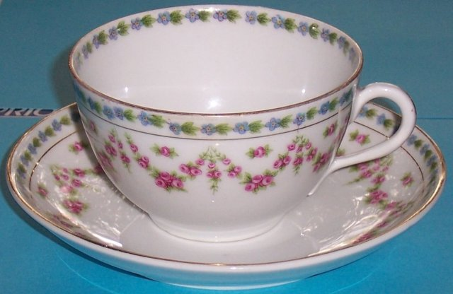 Set of Four Bassett Limoges, Austria Cups and Saucers