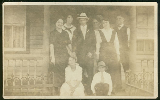 Real Photo Postcard of Large Family Standing on  Porch