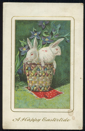 Happy Eastertide Postcard with Bunnies in a Basket 1911