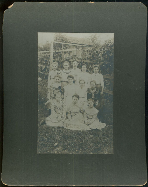 Framed Photograph of Group of Young Girls and Teacher