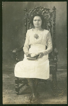 Real Photo Postcard of Young Lady Sitting in Chair