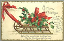 Clapsaddle Christmas Postcard with Sled and Holly 1908
