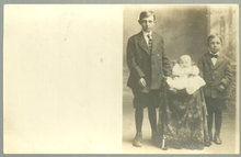 Real Photo Postcard of Two Boys Standing with Baby