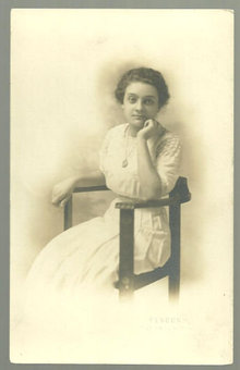 Real Photo Postcard of Lovely Lady Sitting in Chair