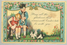 Easter Card with a Boy and Girl Playing with Bunnies