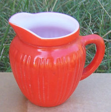 Vintage Orange Fired on Glass Creamer
