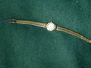 Lady's 18kt Automatic Omega and 18 kt band