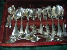 GEORGIAN STERLING ARMORIAL FLATWARE SET