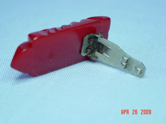 Carved Red Bakelite Dress Clip