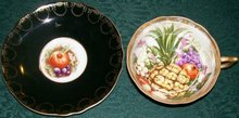 Royal Sealy Cup & Saucer: Black with Fruit Center