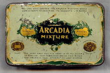Arcadia Mixture Flat Pocket Tobacco Advertising Tin