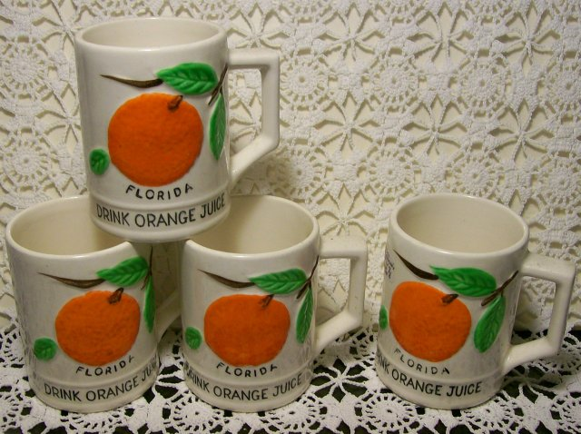 Florida Souvenir Ceramic Juice Mug Set of 4 Embossed Oranges Ca. 1950's