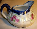 Nippon Cobalt-trimmed Ceramic Creamer: Hand-Painted Roses