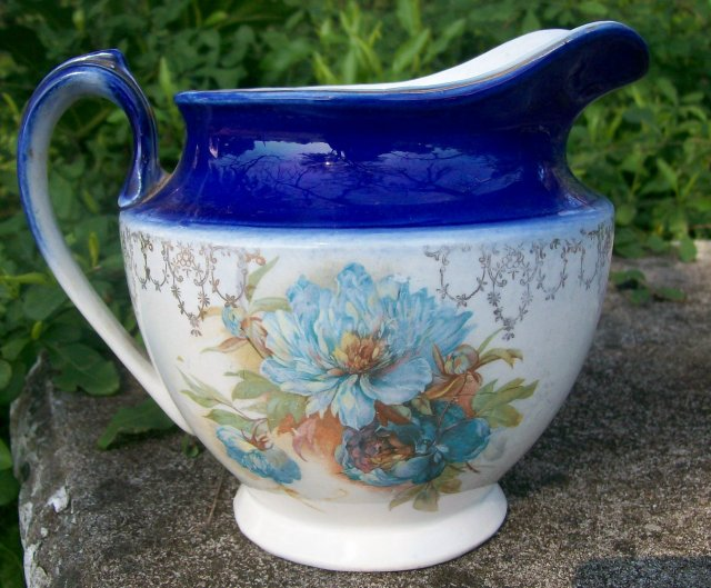 Early American Dinnerware Ceramic Cobalt-trimmed Jug with Floral Decal