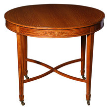 A Small Satinwood Center Table