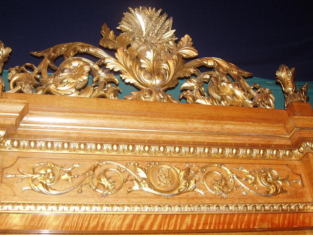A Museum Quality Oak Display Cabinet with fine quality Giltwood Carving to the Crown and Body of the cabinet.