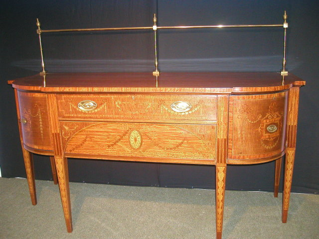 An Important English 19th Century Inlaid Sideboard, in the manner of Sheraton.