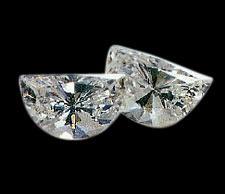 0.50 carat pair of half moon diamonds F VS1 half-moon