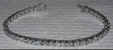 Sparkling Round brilliant diamonds 11 carat tennis bracelet Solid 18K gold white