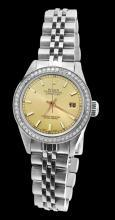 Ladies rolex date just champagne stick dial watch diamond bezel SS jubilee