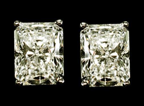 Radiant cut diamond studs 2 ct. earrings white gold