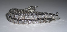 14 carat DIAMOND TENNIS BRACELET VS bezel style setting