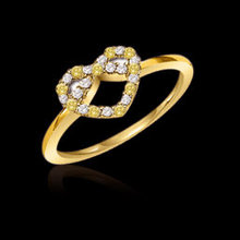 Heart shape fancy yellow diamonds 0.70 ct. ring gold