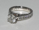 Sparkling diamonds 2.75 ct. solitaire ring with accents