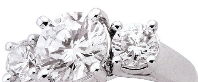 3.01 CARAT three stone diamond ring PLATINUM F/G VS1