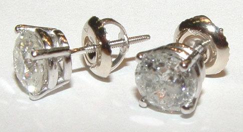 PLATINUM stud earrings in 4.51 carats round G SI1 diamo