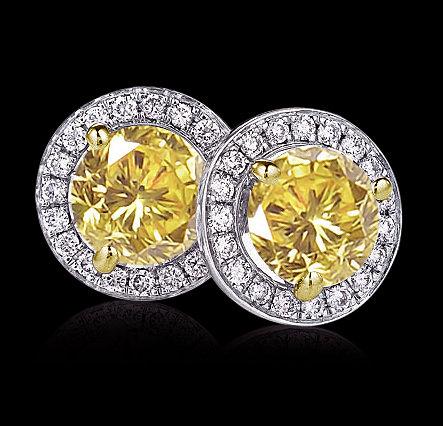 Fancy yellow diamonds 7 cts. Stud earrings gold ear rin