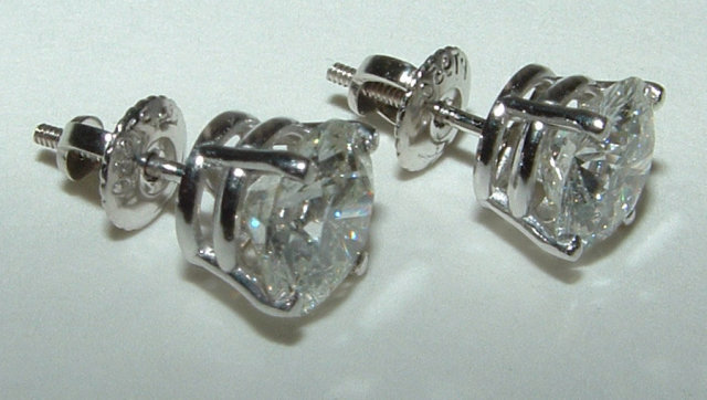 4 CARAT NEW SI1 gorgeous diamond stud earrings new