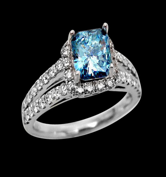 Radiant cut blue diamonds engagement ring white gold