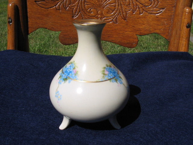 HAND PAINTED LIMOGES FOOTED VASE
