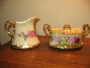 LIMOGES FAMOUS ARTIST PAINTED CREAM AND SUGAR