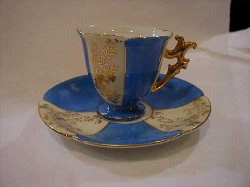 Paneled footed demi cup and saucer