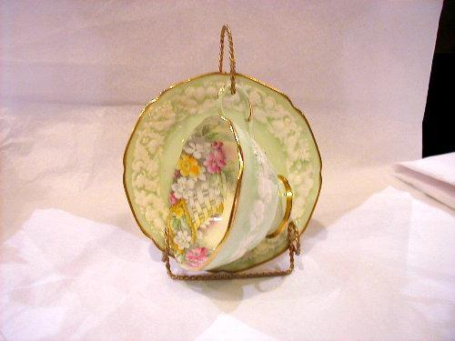 Green flowered cup and saucer