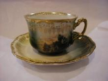 cup and saucer with picture of farm site