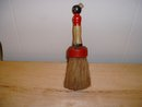 Vintage black folk art whisk brush